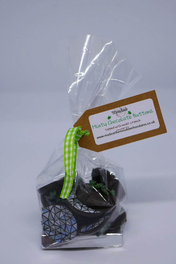 Rich Dark Chocolate buttons flavoured with mint and decorated with a cocoa butter transfer